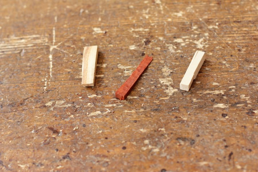 Pieces of scrapwood ready to be turned into necklace pendants